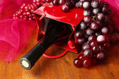 Gift box with wine on wooden table close-up — Stock Photo