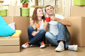 Young couple celebrating moving to new home — Stock Photo