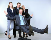 Group of business people on gray background — Stockfoto