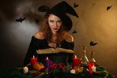 Halloween witch on dark background — Stock Photo