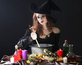 Halloween witch on black background — Stock Photo