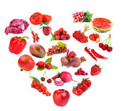 Fruits and vegetables in heart shape isolated on white — Stock Photo