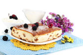 Cheese casserole with raisins on plate on napkin isolated on white — Stock Photo