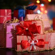 Many gifts on bright background — Stock Photo #33660603