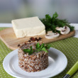 Buckwheat in plate and butter closeup — Stock Photo