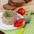 Buckwheat in plate with bread and vegetables closeup — Stock Photo