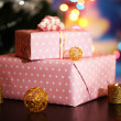 Stock Photo: Many gifts on bright background