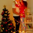 Happy young couple near Christmas tree at home — Stock Photo #33662693