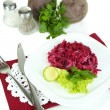Stock Photo: Beet salad on plate on napkins isolated on white