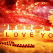 Candles with printed sign I LOVE YOU,on bright background — Stock Photo