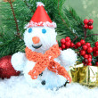 Beautiful snowman and Christmas decor, on bright background — Lizenzfreies Foto