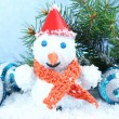 Beautiful snowman and Christmas decor, on blue background — ストック写真