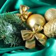 Beautiful Christmas decor on green satin cloth — Stock Photo #33664309