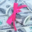Dollars with gift bow close-up — Stock Photo #33664687