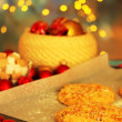 Process of making New Year cookies on Christmas lights background — Stockfoto
