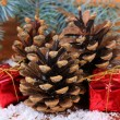 Christmas decoration with pine cones on wooden background — Stok Fotoğraf #33665479