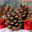 Christmas decoration with pine cones on wooden background — Stock fotografie #33665479