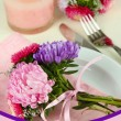 Festive dining table setting with flowers — Stock Photo