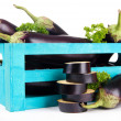 Fresh eggplants in wooden box isolated on white — Stock Photo