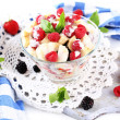 Fruit salad in glass bowl, isolated on white — 图库照片