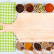 Various spices and herbs with empty wooden board — Stock Photo #33666799