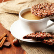 Cup of tasty coffee with tasty cookies, on wooden background — Stock Photo #33666957