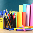 Office supplies on table on school board background — Stock Photo #33667133