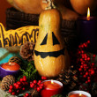 Composition for Halloween with pumpkins and candles close-up — Stock Photo #33668193