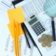 Stock Photo: Office supplies with money and documents close up