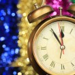 Golden clock on bright background — Stock Photo
