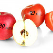 Stock Photo: Calorie content of apple and tomato isolated on white