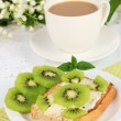 Delicious toast with kiwi on table close-up — Stock Photo