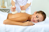 Beautiful young woman having back massage close up — Stock Photo