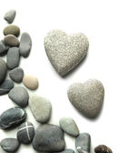 Grey stones in shape of heart, isolated on white — Zdjęcie stockowe