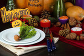 Table setting for Halloween with pumpkin and candles close-up — Stock Photo