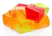 Tasty jelly cubes isolated on white — Stock Photo