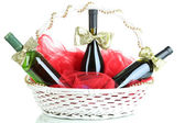 Gift basket with wine isolated on white — Stock Photo
