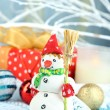 Beautiful Christmas composition with gift and Christmas toys close-up — Stock Photo #33670365
