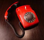 Red retro telephone,on dark background — Stock Photo