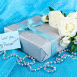 Romantic parcel on blue cloth background — Stock Photo #33730833