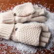 Wool fingerless gloves, on wooden background — Stock Photo