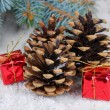 Christmas decoration with pine cones on wooden background — Stok Fotoğraf #33733089
