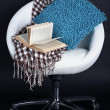 White chair with pillow on black background — Stock Photo