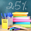 Office supplies on table on school board background — Stock Photo