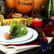 Table setting for Halloween with pumpkin and candles close-up — Stock Photo #33735097