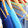 Clothes on circle hanger on light background — Stock Photo