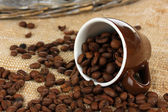 Coffee beans in cup on table close-up — Stock Photo