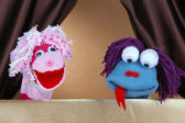 Puppet show on brown background — Stock Photo