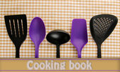 Plastic kitchen utensils on fabric background — 图库照片