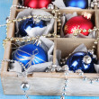 Stock Photo: Christmas toys in box on wooden table close-up